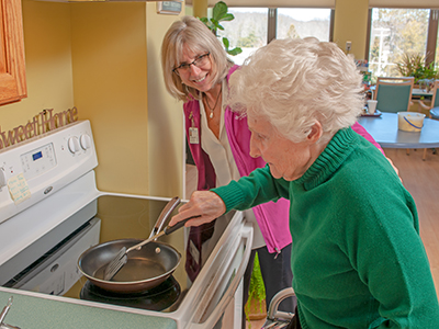 Occupational therapist cooking with a patient