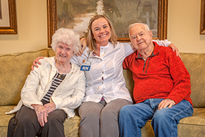 A nurse with assisted living residents