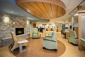 The infusion suite at the Cowell Family Cancer Center includes a fireplace