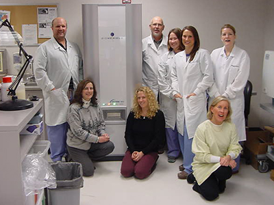 Munson Medical Center staff with new microbiology lab equipment